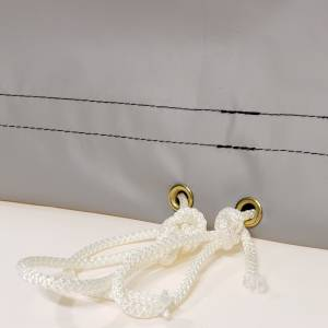bt-string-solid-braid-rope-drawstring-inserted-into-hem-of-boxed-shaped-tarps-close-up